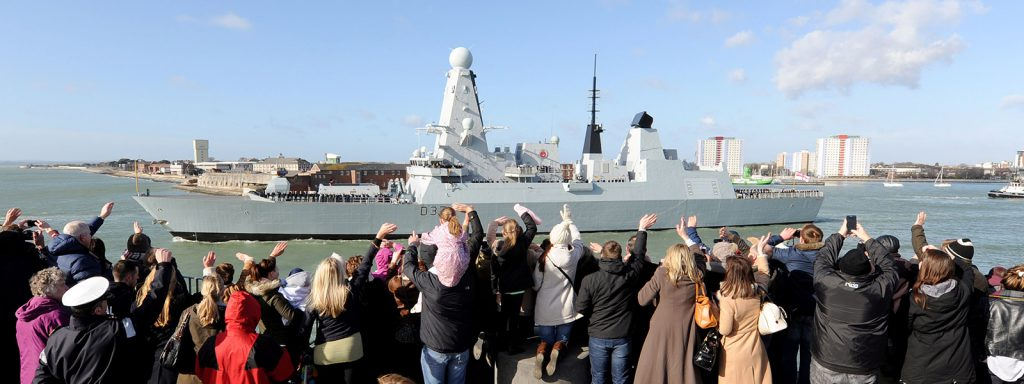 Type 45 destroyer with families waving