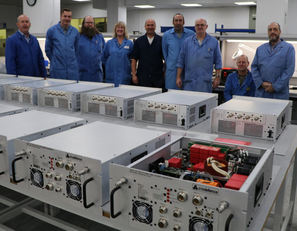 Engineers with equipment they produced