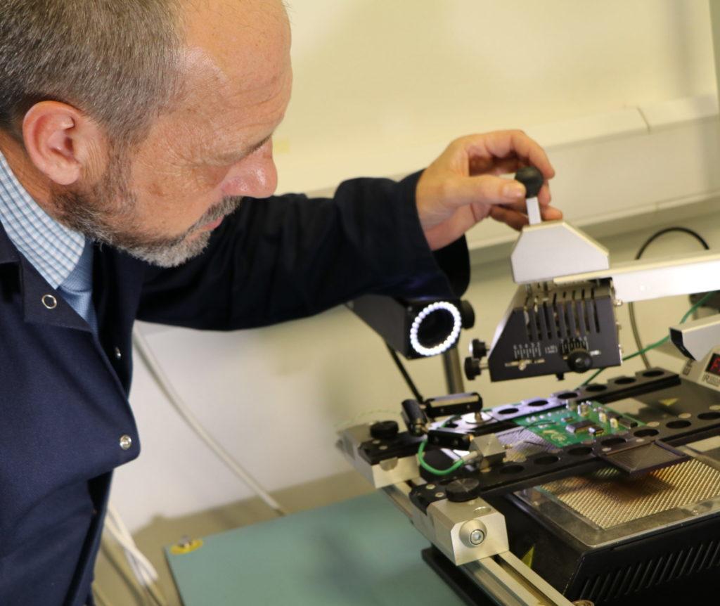 Engineer using Surface Mount machine